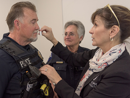 Police officer being trained to use Naloxone