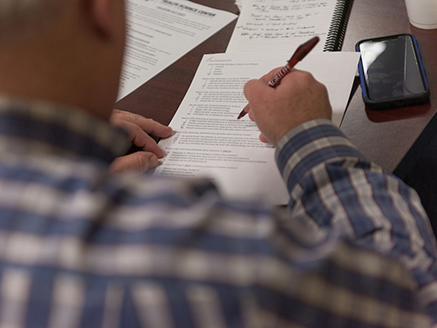 A man filling out an opioid research questionnaire