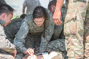 soldier medical student learning on simulated patient