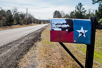mailbox painted with a Texas flag